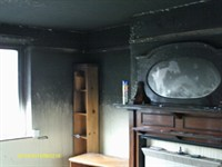 Smoke damage to ceiling and walls