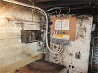 New electrical intake surrounded by fire damage