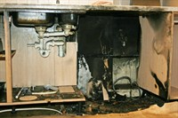 Damage to the kitchen cupboards where the diswasher was located