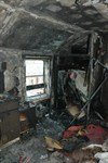 Extensive damage to the bedroom where the fire started