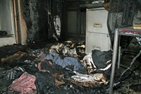 Fire damage with laundry on the floor