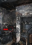 The toaster (circled in red) is covered by the remains of the kitchen cupboard that was above it
