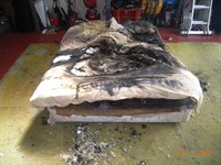 The bed damaged in the fire.