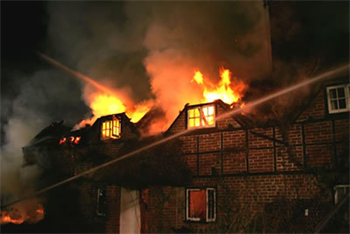 Fire caused by an unattended scented candle placed too close to curtains caused a major fire and significant damage..
