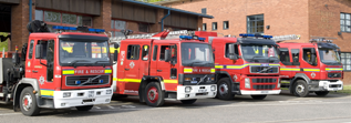 Picture of fire appliances outside a fire station